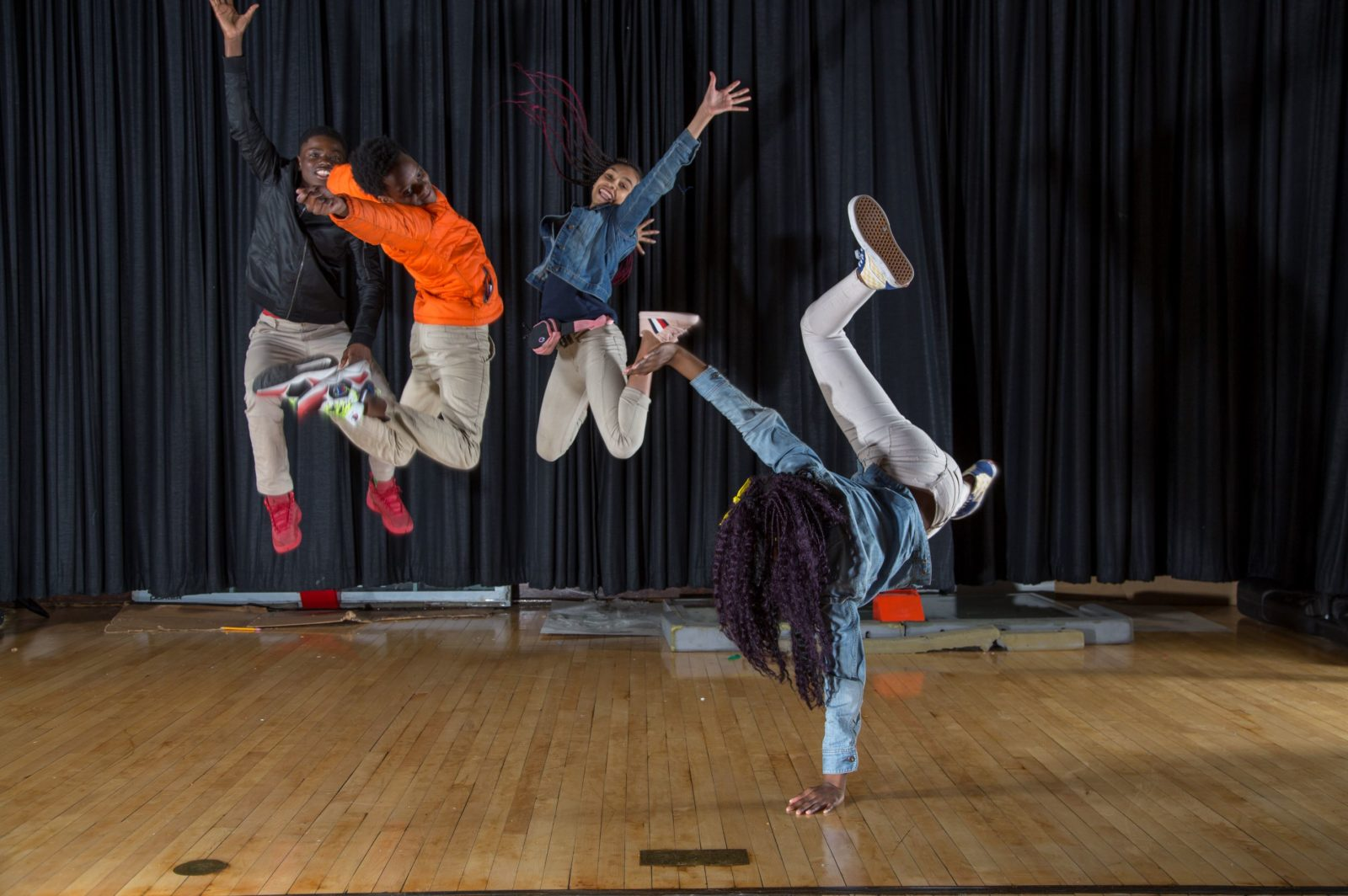photo by Cecil McDonald Jr. from moment in time exhibition of 8th grade students jumping to signify joy at art on sedgwick